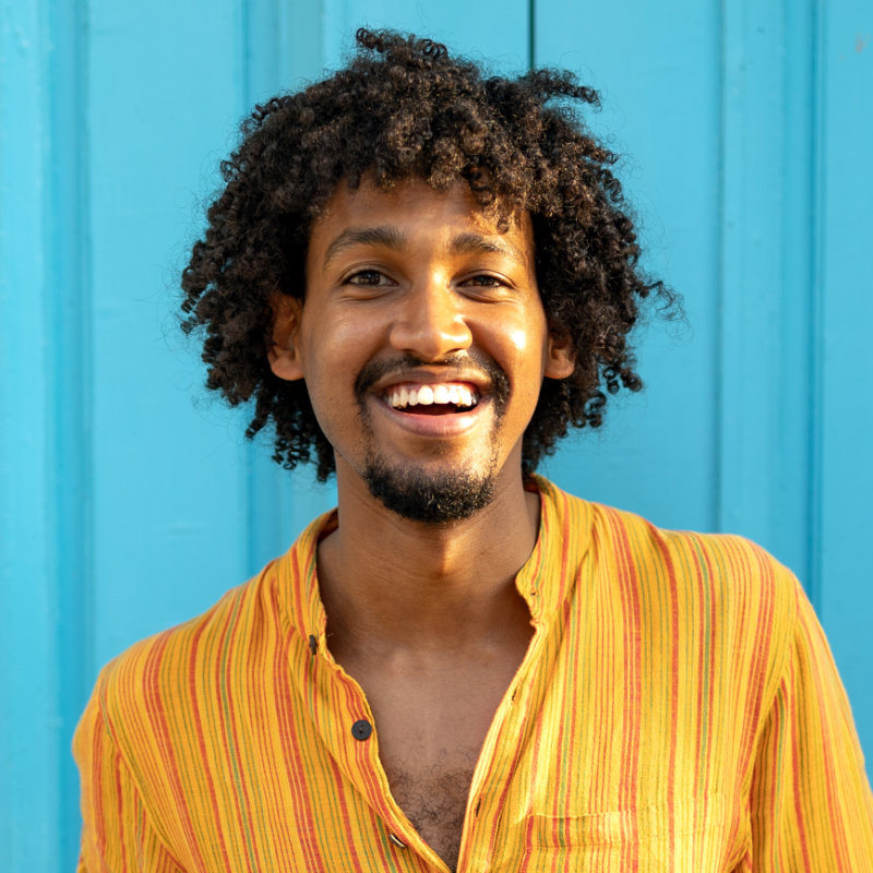 close-up-portrait-of-a-happy-african-american-man-LQVG43V.jpg